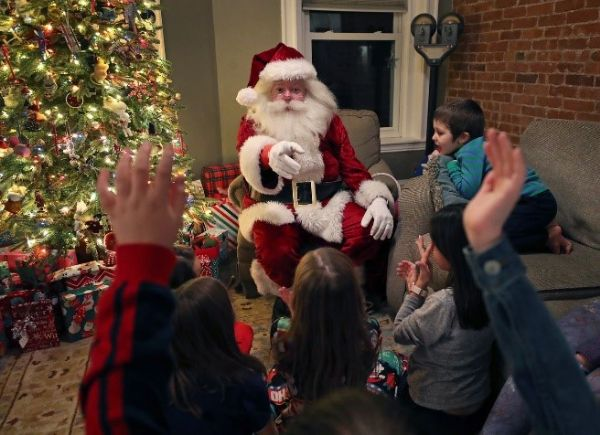 Jim Manning as Santa Claus asked children who knows the names of Santa's reindeer during a private house party.