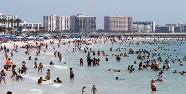 Clearwater beach nearly at capacity during Memorial Day weekend as law enforcement limits crowds to provide for proper social distancing Saturday. [LUIS SANTANA  |  Times]